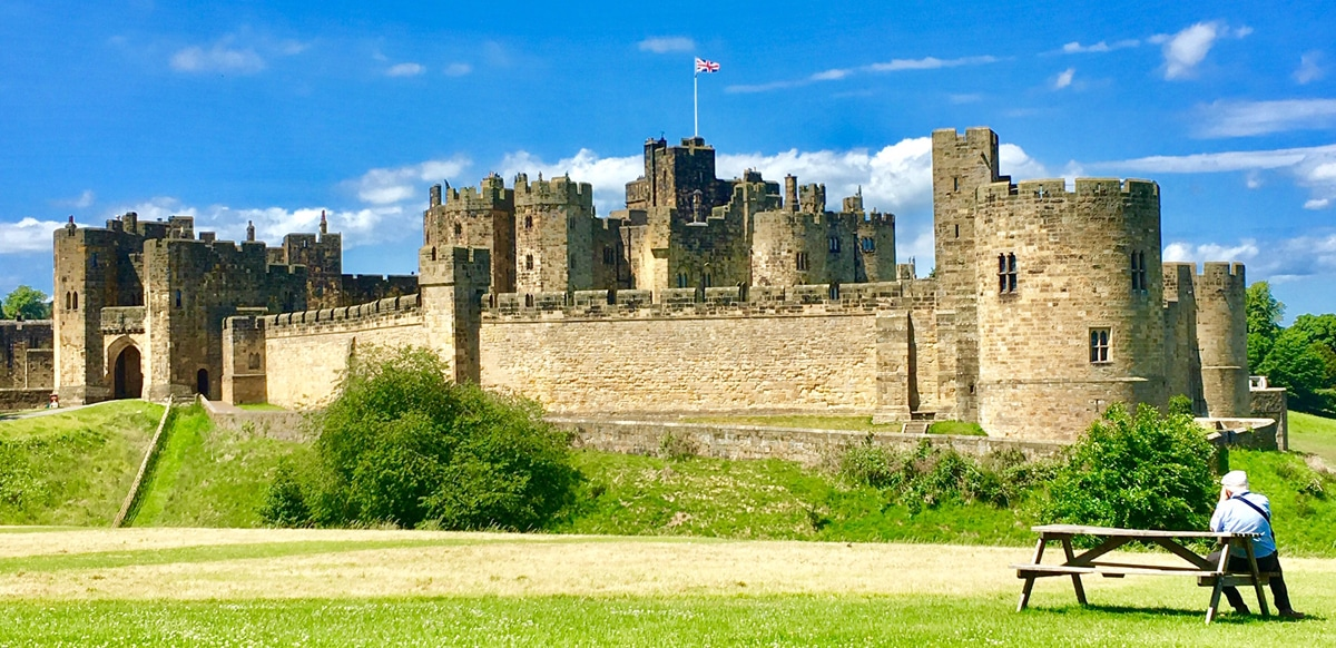 Admiring Alnwick Castle from a bench in the grounds of the castle.