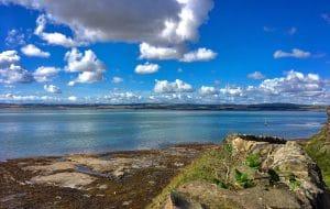 Lindisfarne Island, calm sea,blue skies & sandy beach