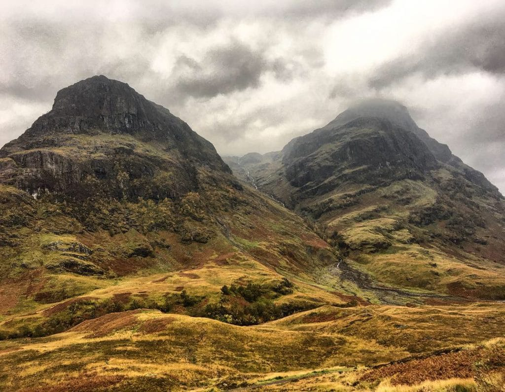 The mountains of Glencoe,Scotland in Autumn. Mist covers the tops of these Scottish mountains known as the 3 sisters of Glencoe.