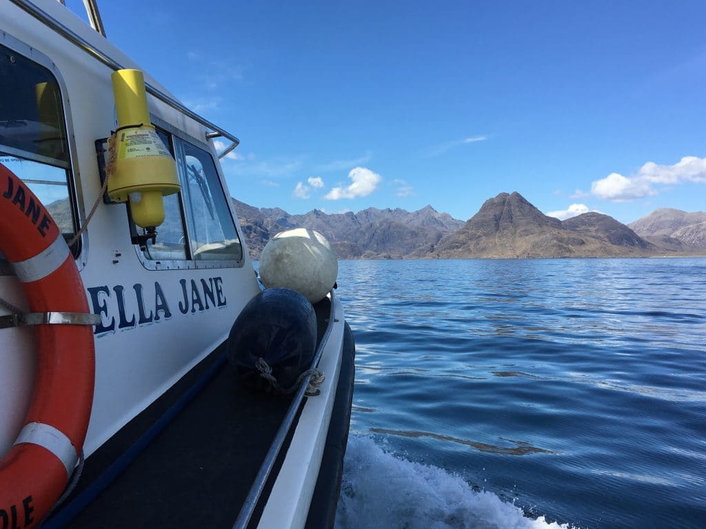 The Bella Jane boat sails across Loch Scavaig ready to encounter the grey seals. Basking sharks and dolphins are regular visitor